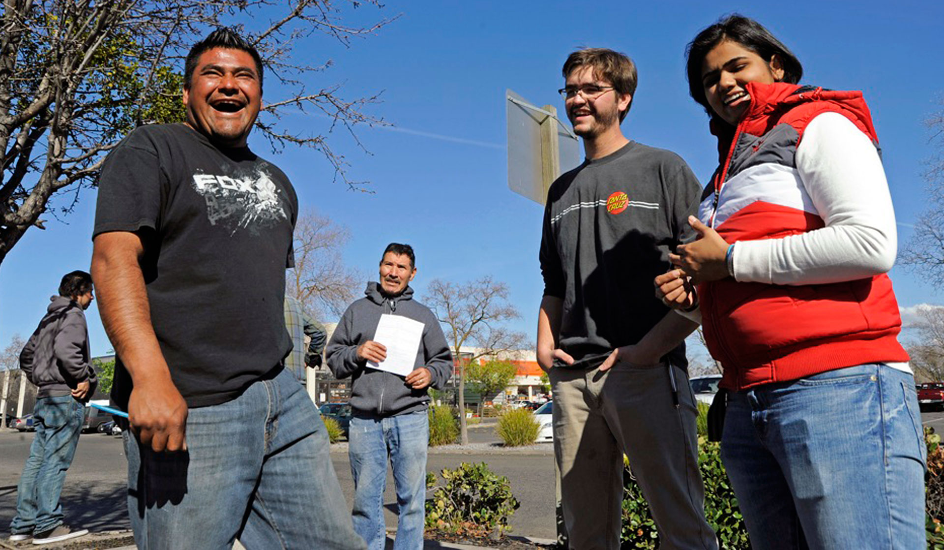 Day laborer Pedro Flores (L) and students Wyatt Irmen and Nimra Syed take part in the intercambio.