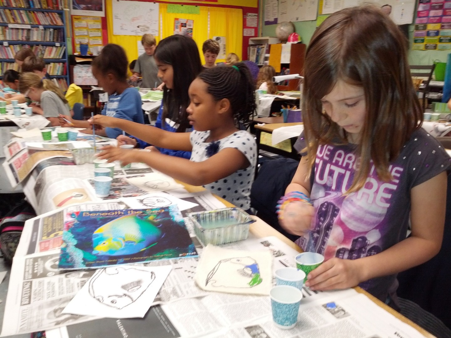 Fourth-graders in Ana Thomas' class at Peralta Elementary paint marine animals on fabric for a quilt.