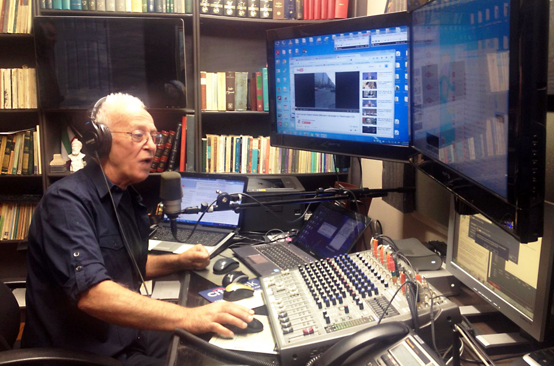 """Saeed Ghaemmaghami takes calls from listeners around the world during his Internet broadcast, Radio Sedaye Mardom, Farsi for """"The People's Voice."""""""