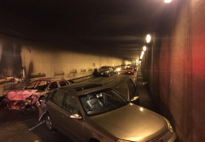 Cars involved in Monday morning crash and fire that shut down one of the Caldecott Tunnel's eastbound bores Monday morning, with abandoned vehicles in background.
