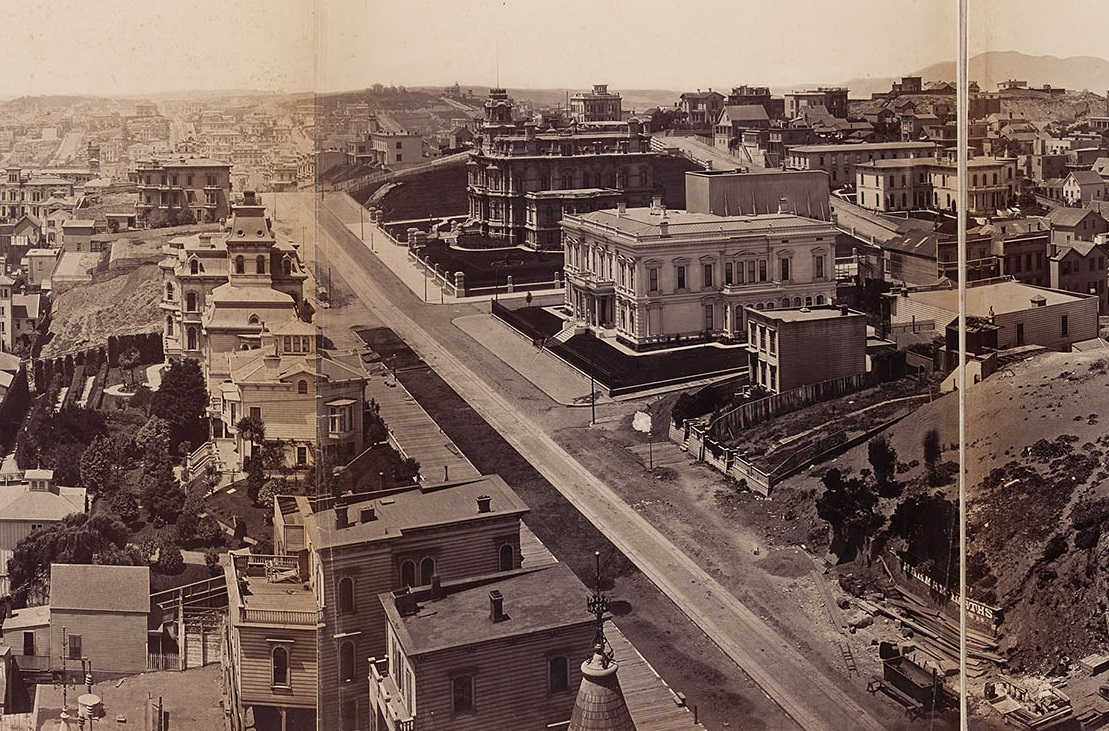 A panorama of San Francisco taken in 1878 from the Mark Hopkins mansion on Nob Hill by photographer Eadward Muybridge.  The large, dark-colored edifice at center was the home of railroad magnate Charles Crocker. The spite fence he built to retaliate against neighbor Nicholas Yung is the large rectangular structure to the right of the mansion in this image. This copy of the panorama is in the collection of the Society of California Pioneers and was restored in 2011 by Gawain Weaver Art Conservation. Eadward Muybridge/Gawain Weaver Art Conservation