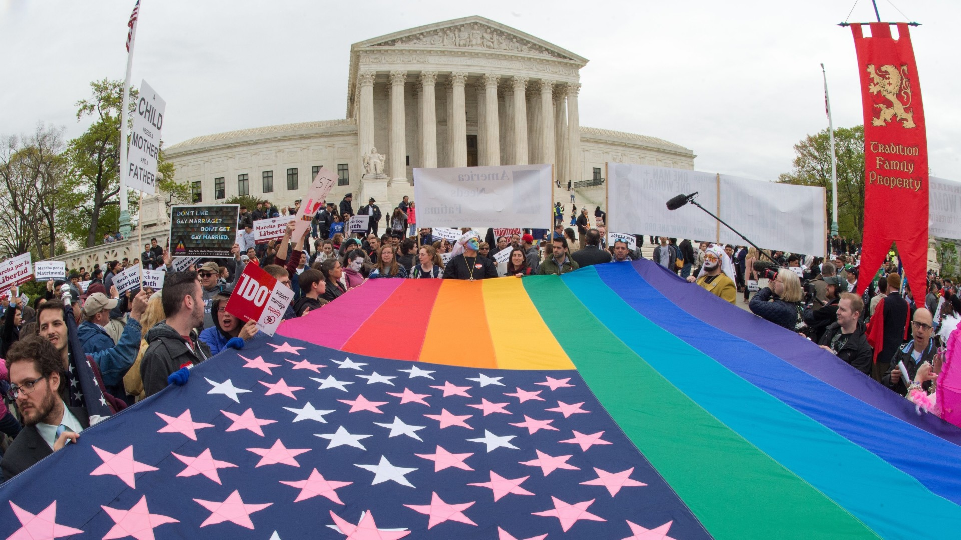 Protesters hold a pro-gay rights flag outside the U.S. Supreme Court in April 2015.