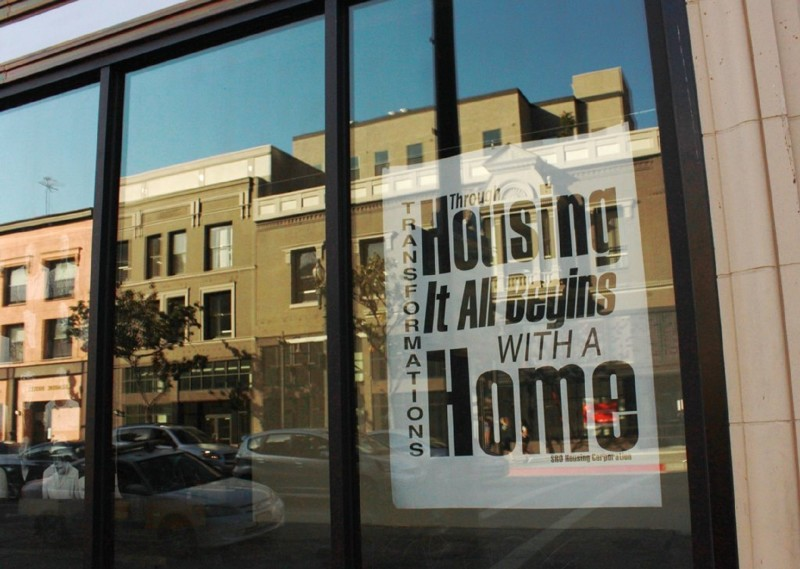 A sign on the window of the SRO Housing Corporation in Skid Row