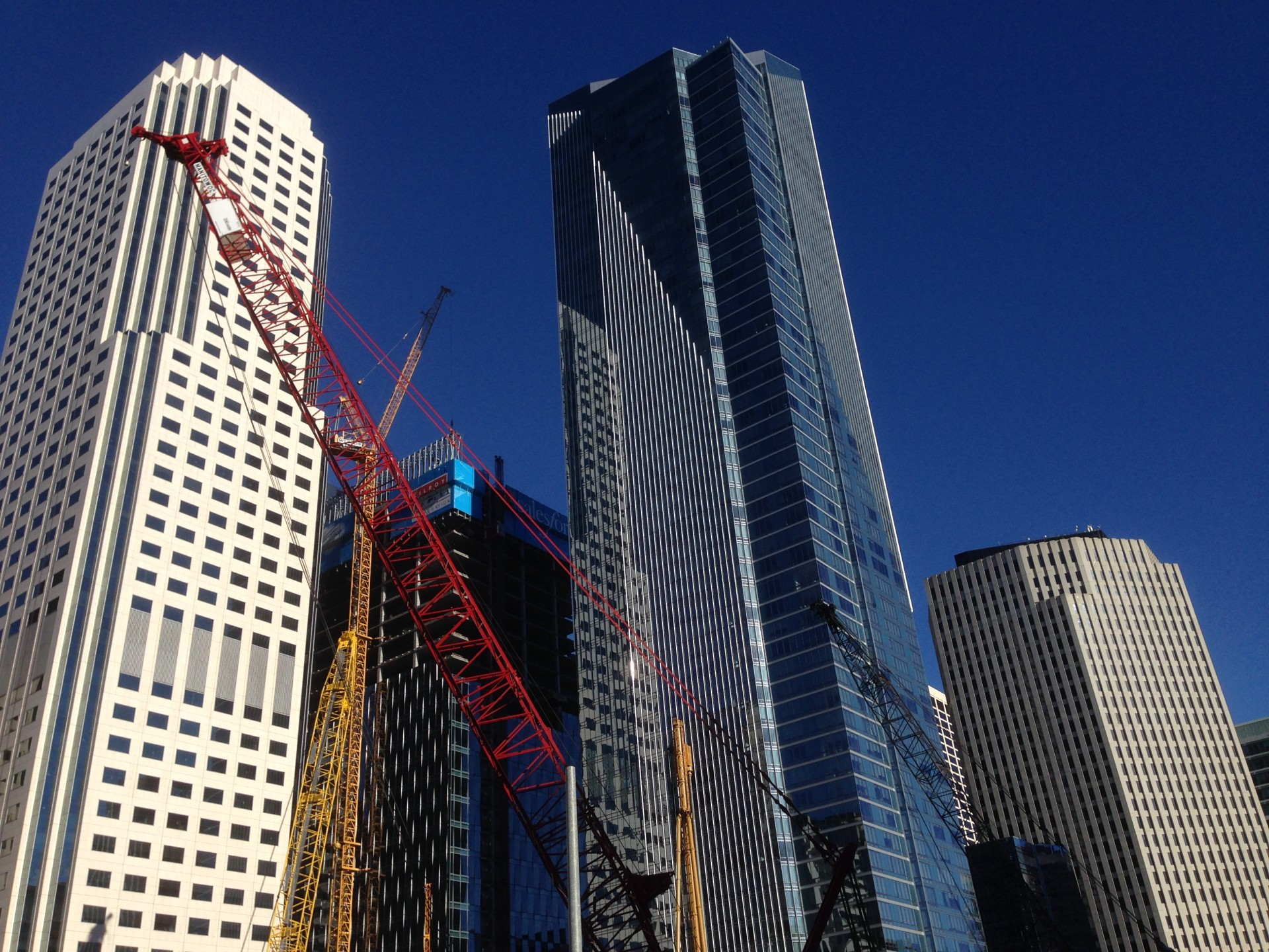 Construction cranes and gleaming new buildings reflect the changing face of San Francisco.