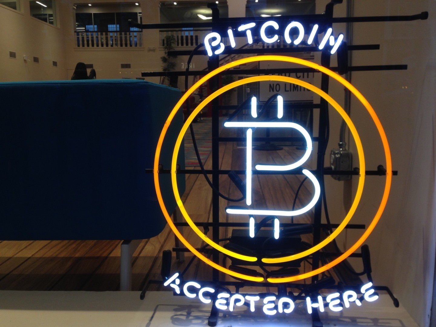 A neon sign in the window at Draper University of Heroes in San Mateo, where many Bitcoin startups are born.