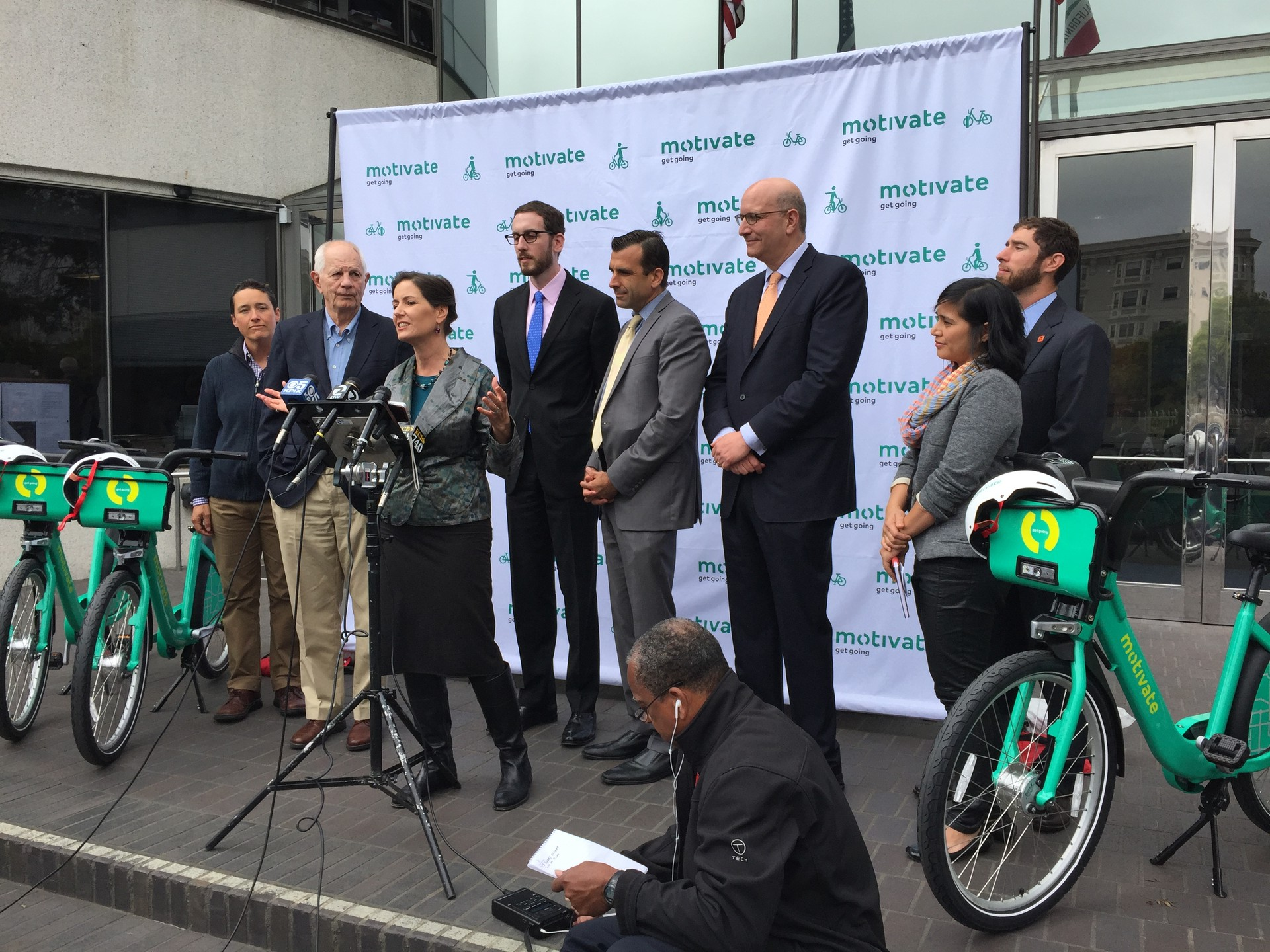 Oakland Mayor Libby Schaaf, surrounded by Bay Area city officials and advocates, at a press conference announcing the significant expansion of Bay Area Bike Share.