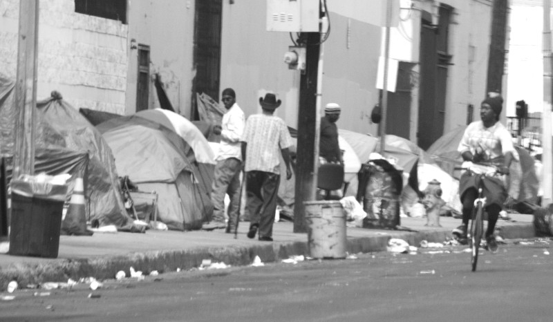 A Skid Row sidewalk encampment at the southern edge of Skid Row, home to the city's warehouse and art district.
