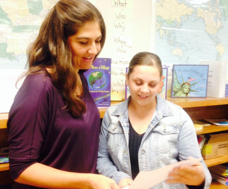 Student Hilda Sanchez (right) gets help from ESL teacher Sarah Motola.