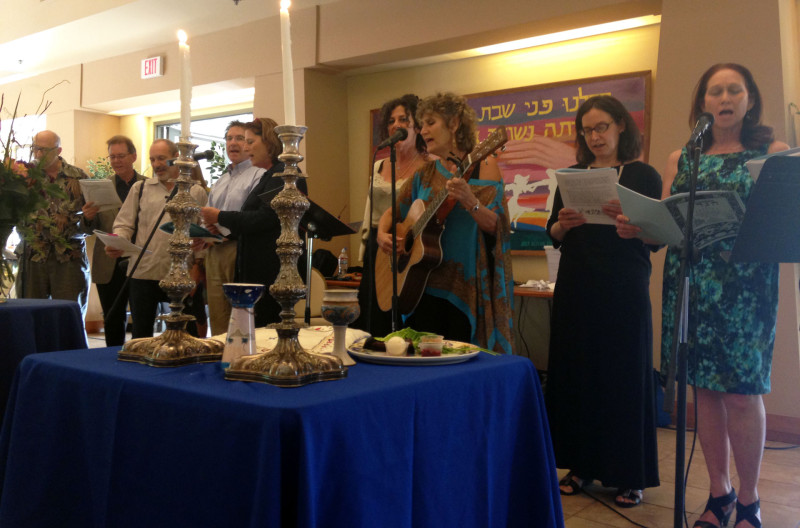 """Graduates of the Valley Kindershule sing """"In Dem Land Fun Piramidn"""" in Yiddish at the Erev Shabbos Discussion Group seder on Sunday, March 29, 2015."""