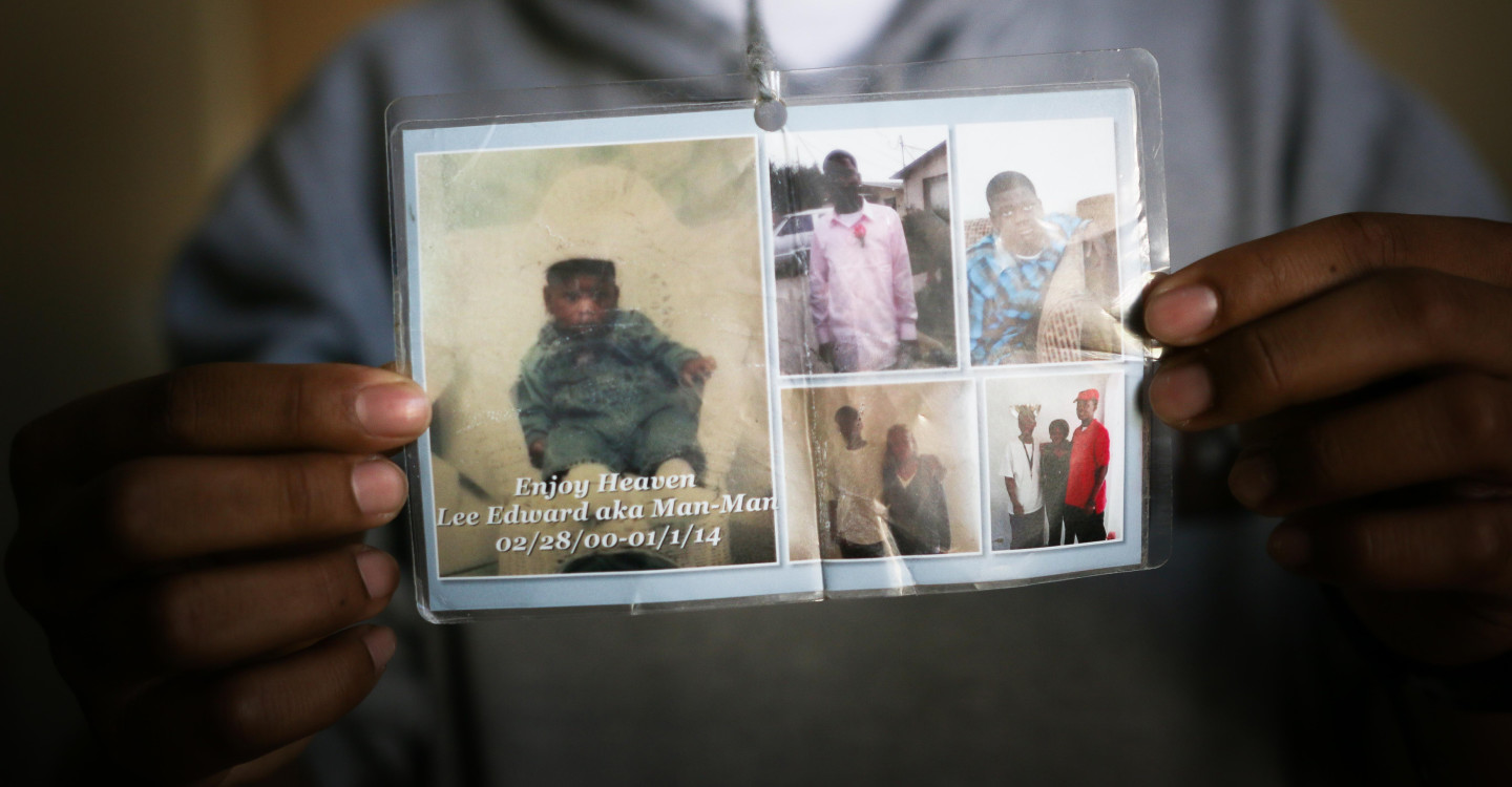Diamond Allen shows off pictures of his friend Lee Weathersby III, who was shot and killed in Oakland. (Jeremy Raff/KQED)