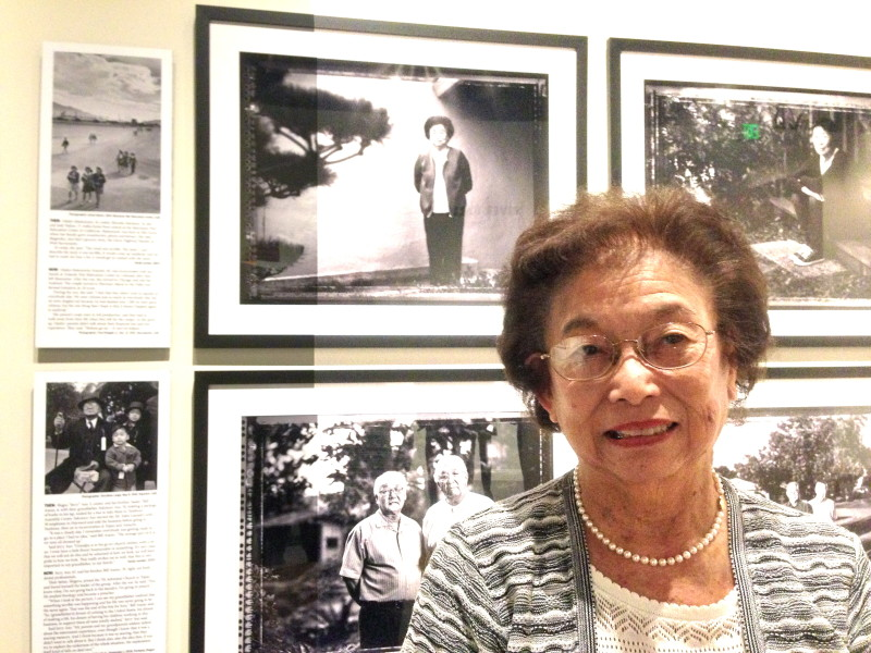 Gladys Matsumoto Katsuki stands in front of a 1943 Manzanar photo by Ansel Adams, top left, where she's in the middle. To its right is her portrait by Paul Kitagaki Jr. in 2012.
