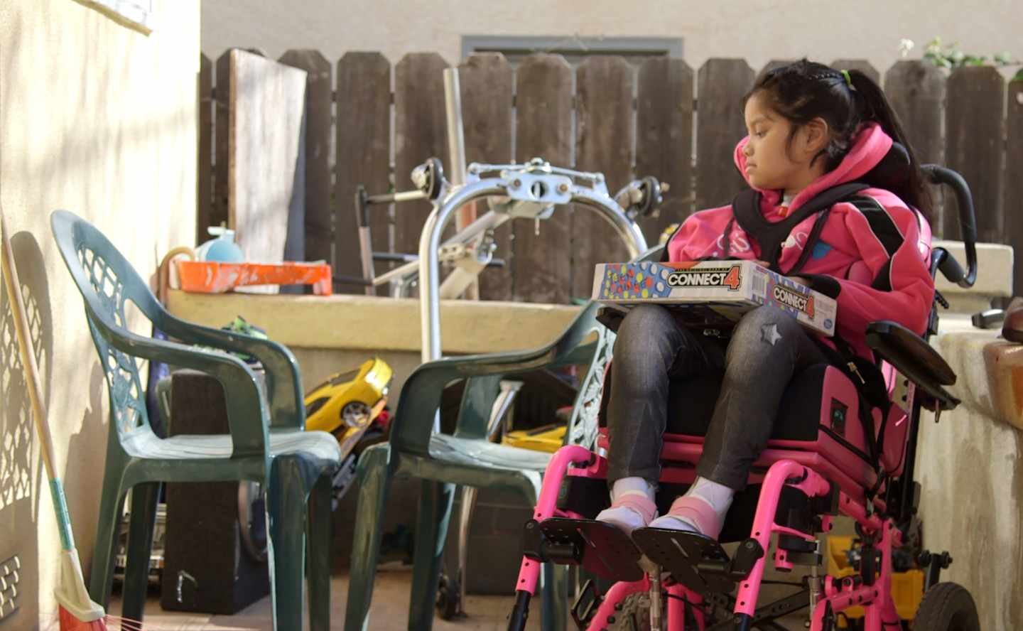 9-year-old Jacqueline Funes was paralyzed from the neck down after being shot in the neck while playing in front of her house. (Adam Grossberg/KQED)