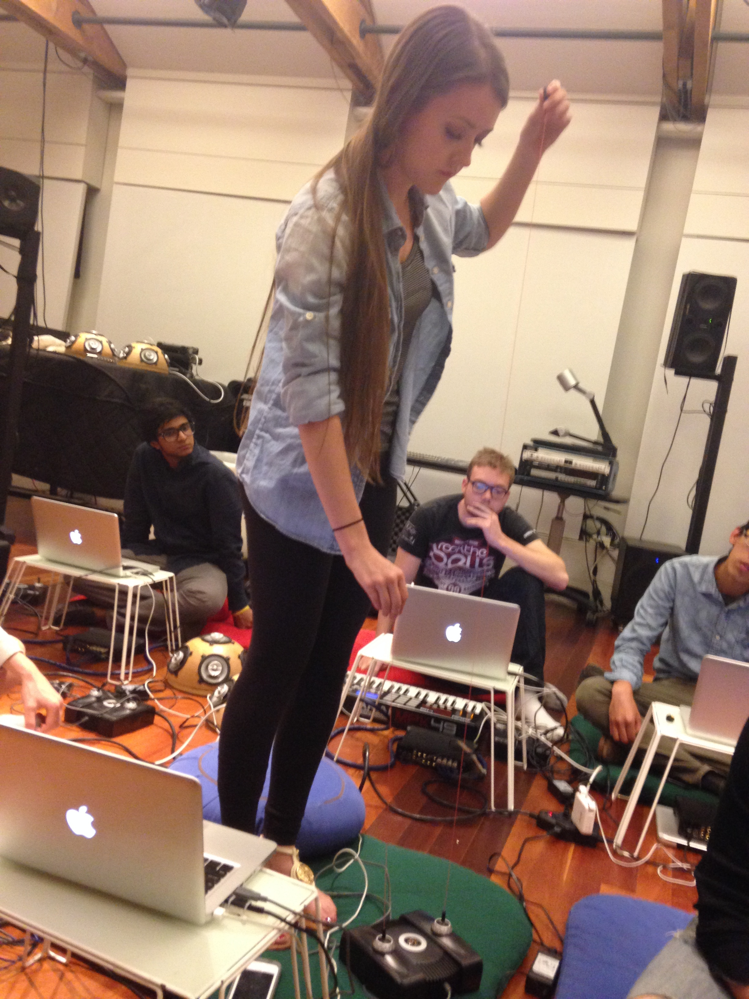 Erica Fearon demonstrates a piece of music she composed on her laptop. She programmed the cables to make different sounds when she moved them in different directions.