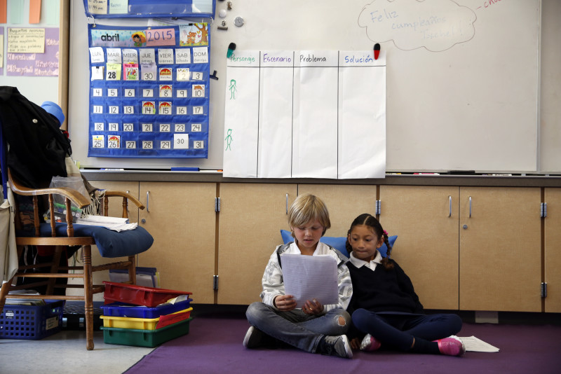 Spanish-immersion second-graders Deven Finnemore and Lia Palma read together at Monroe Elementary School in San Francisco, Calif., on Wednesday, April 29, 2015.