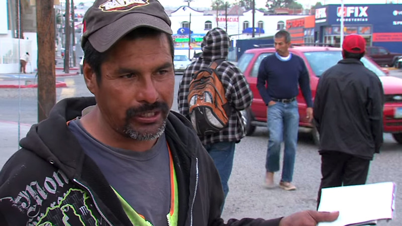 Cesar Jimenez Sanchez has waited daily at this corner outside a Costco in Tijuana for the past five years, hoping to pick up odd jobs. He was deported following a DUI arrest, leaving behind a wife and eight children in the U.S.