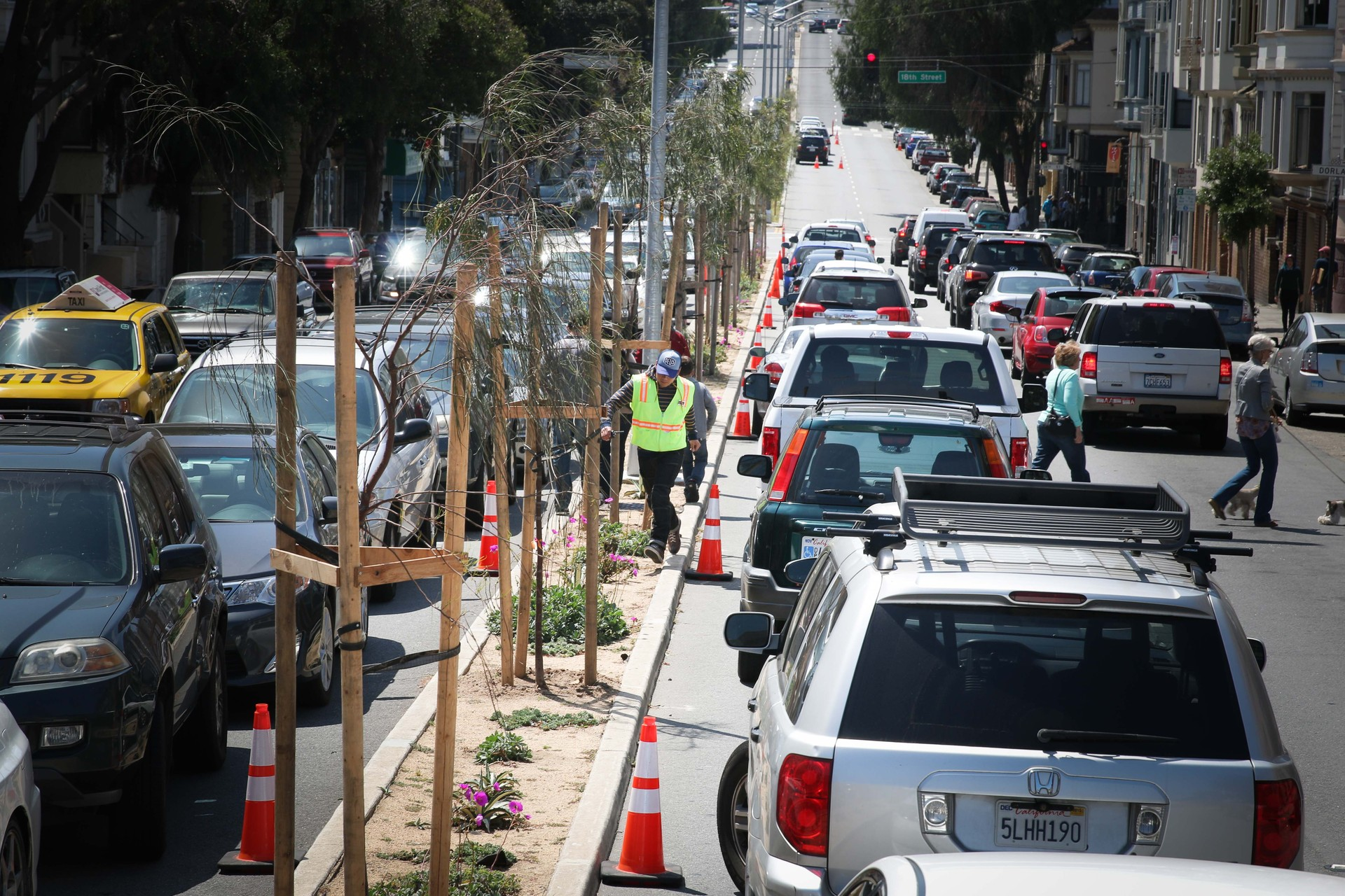 On Sundays, Cornerstone Church's volunteer parking attendants help their members double-park on Guerrero between 17th and 18th streets. When services are finished around 1:30 p.m., they call SFMTA to ticket anyone still parked in the street.