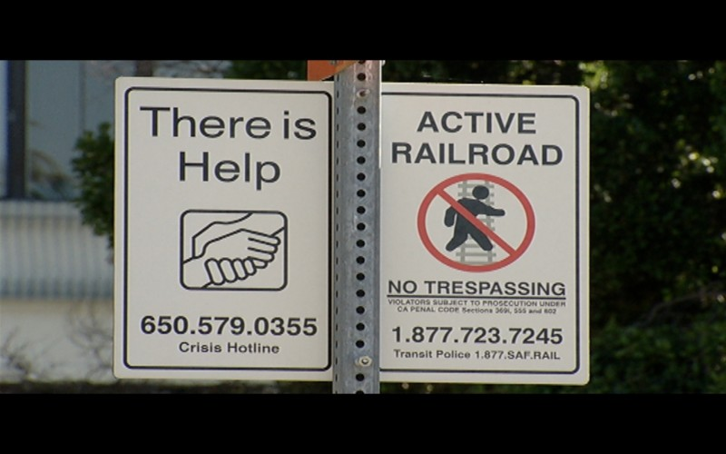 Hundreds of signs along Caltrain tracks and stations urge people to reach out for support.