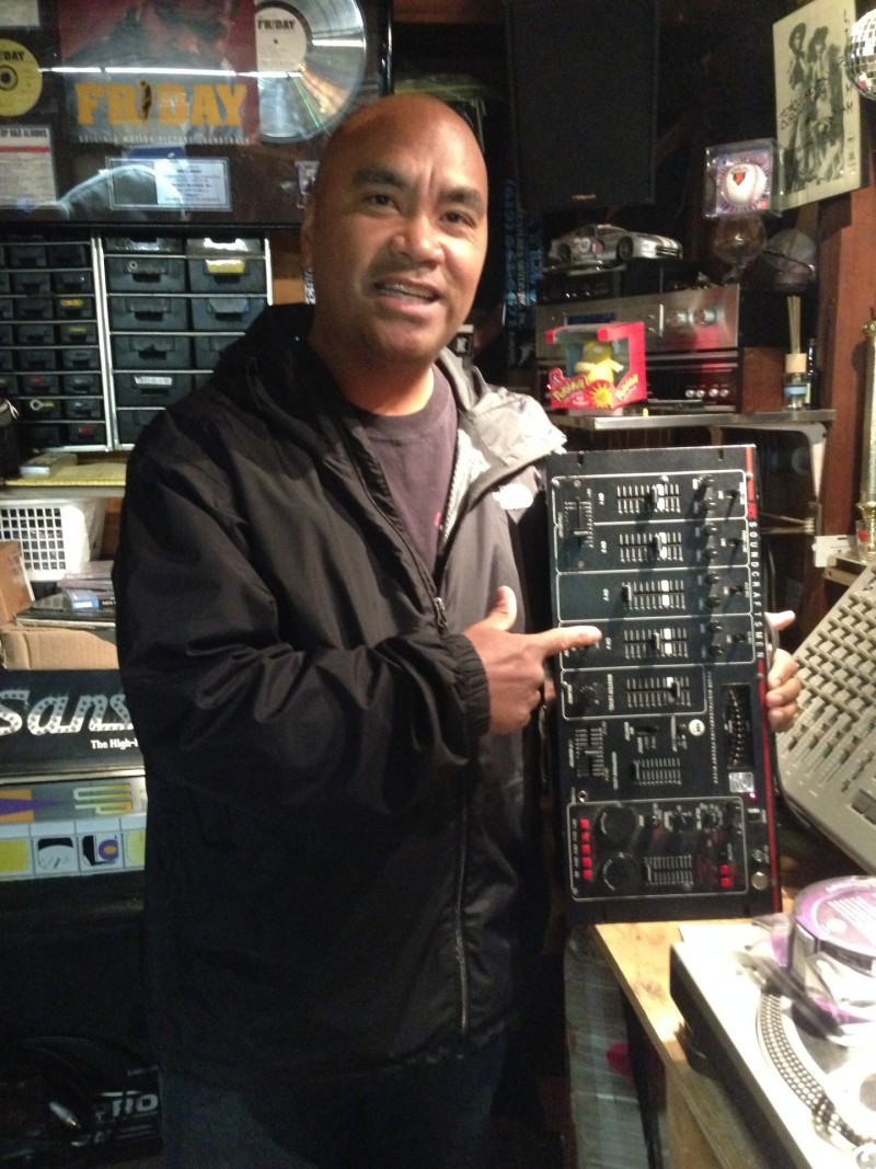Orlando Madrid with an old mixer he used to deejay with back in the '80s.