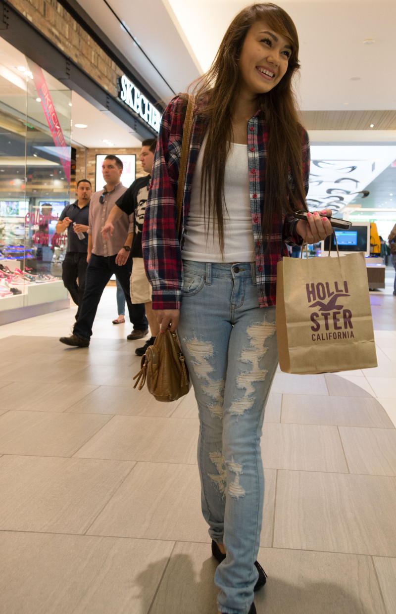 Lupe Herrera loves the mall, where she can be a typical American teen, checking out her favorite brands and keeping friends close through text messages on her cellphone.