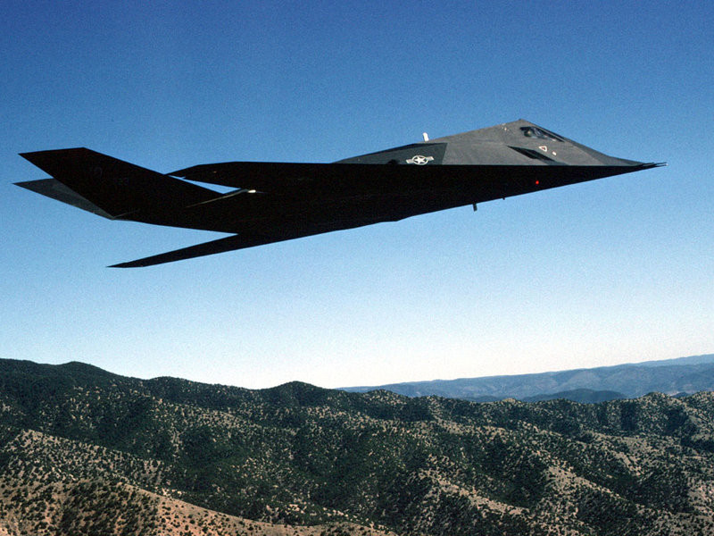 In this undated handout photo, the F-117A Nighthawk stealth fighter — from the 49th Fighter Wing, 9th Fighter Squadron — flies during a training mission over the New Mexico desert.