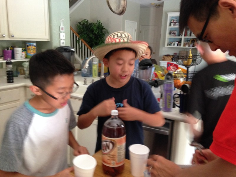 The kids take a root beer float break with their coach Kevin Murai.