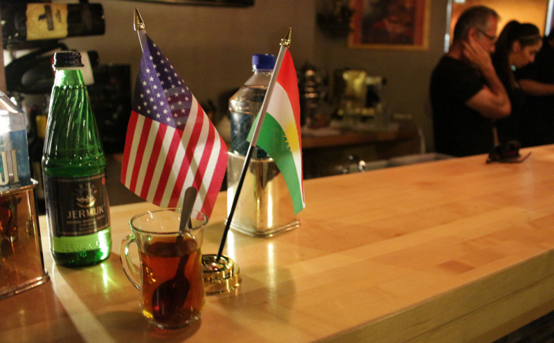 Kurdish and United States flags fly at Niroj Kurdish Cuisine's bar.