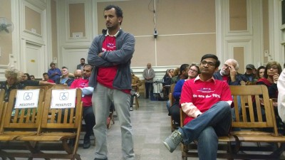 Shop owners waiting to testify as Berkeley City Council weighed strict limits on tobacco sales in the city.