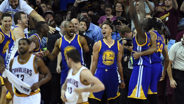 The Golden State Warriors celebrate defeating the Cleveland Cavaliers 105-97 in Game 6.