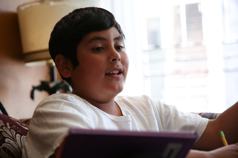 Angel Luque does homework after school.