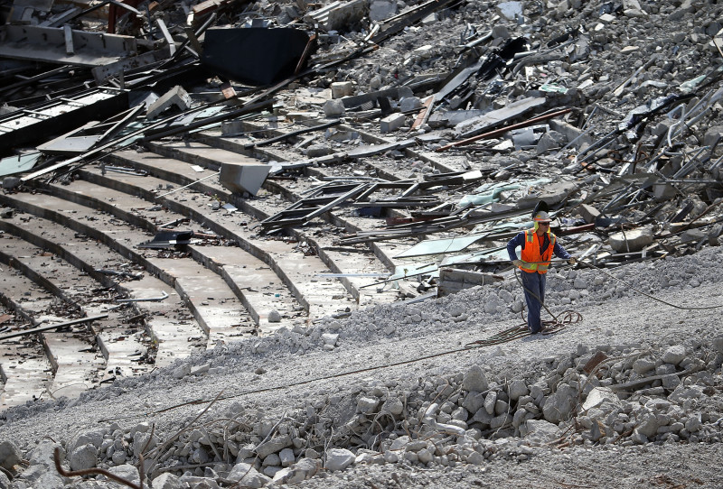 June 9: A worker amid the Candlestick Park rubble.