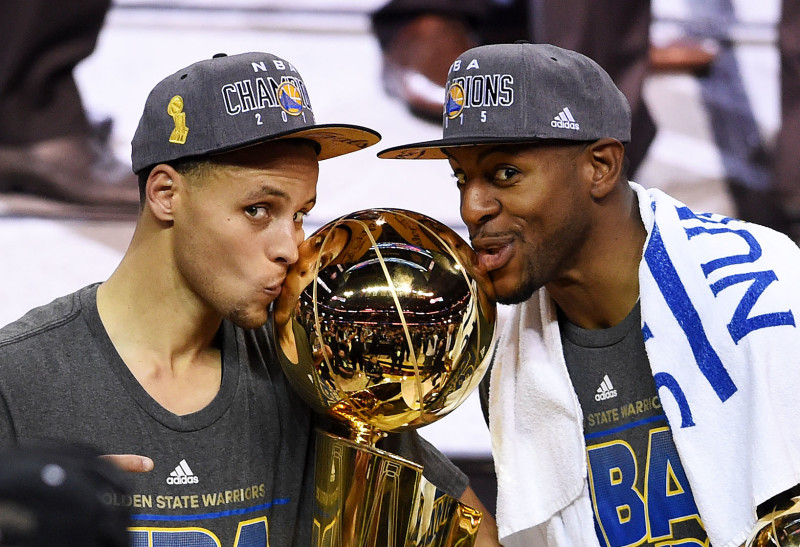 Stephen Curry and Andre Iguodala celebrate with the Larry O'Brien NBA Championship Trophy after defeating the Cleveland Cavaliers in Game Six of the 2015 NBA Finals. (Jason Miller/Getty)