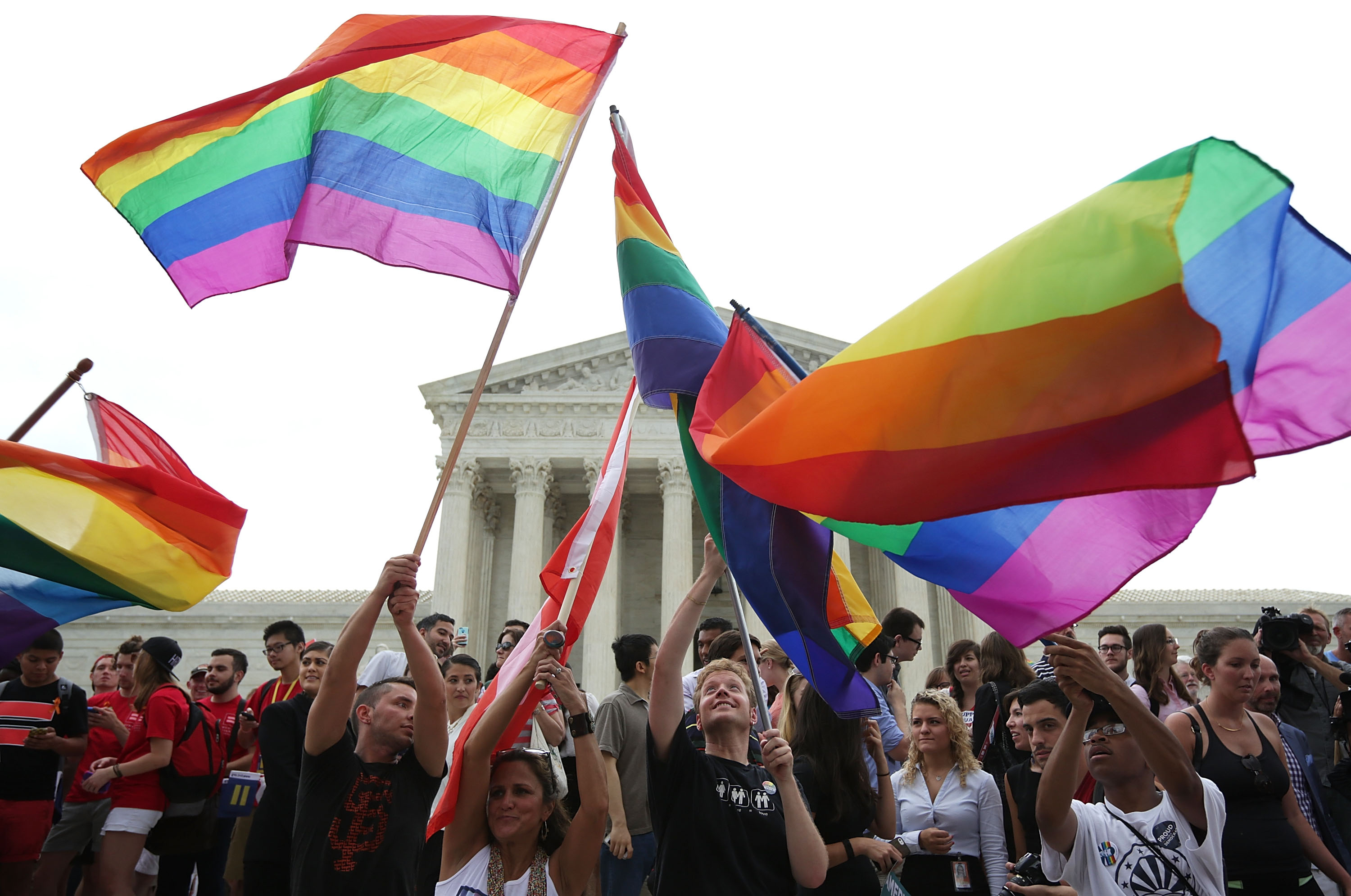 Same-sex marriage supporters rejoice after the U.S Supreme Court hands down a ruling regarding same-sex marriage June 26, 2015 outside the Supreme Court in Washington, DC. The high court ruled that same-sex couples have the right to marry in all 50 states.