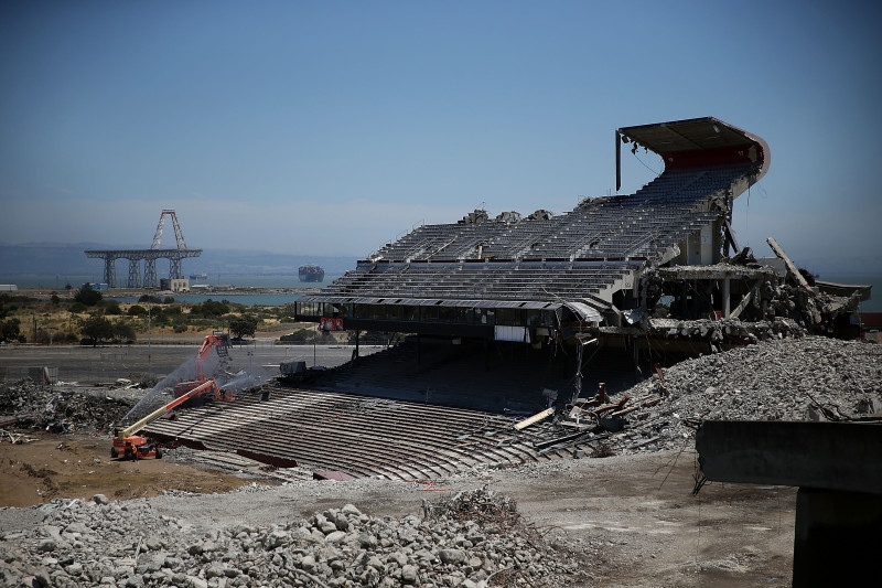 June 26: One final section of Candlestick Park remained standing. In the distance: the site of the old Hunters Point Naval Shipyard.