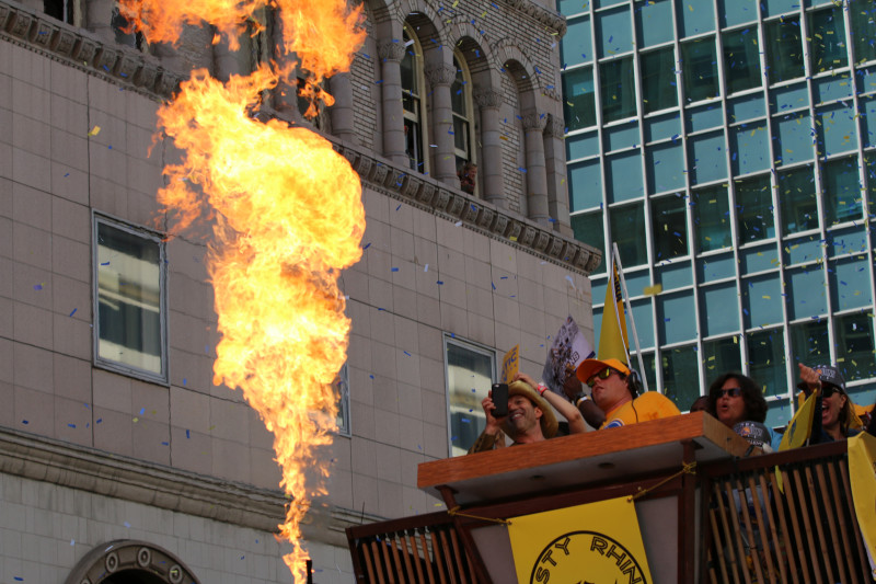 A parade float called the 'Dusty Rhino' shot flames out of snout at the front of the vehicle. (Adam Grossberg/KQED)