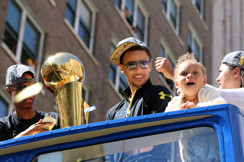Stephen Curry and his daughter Riley celebrate during the Warriors championship parade Friday. (Adam Grossberg/KQED)