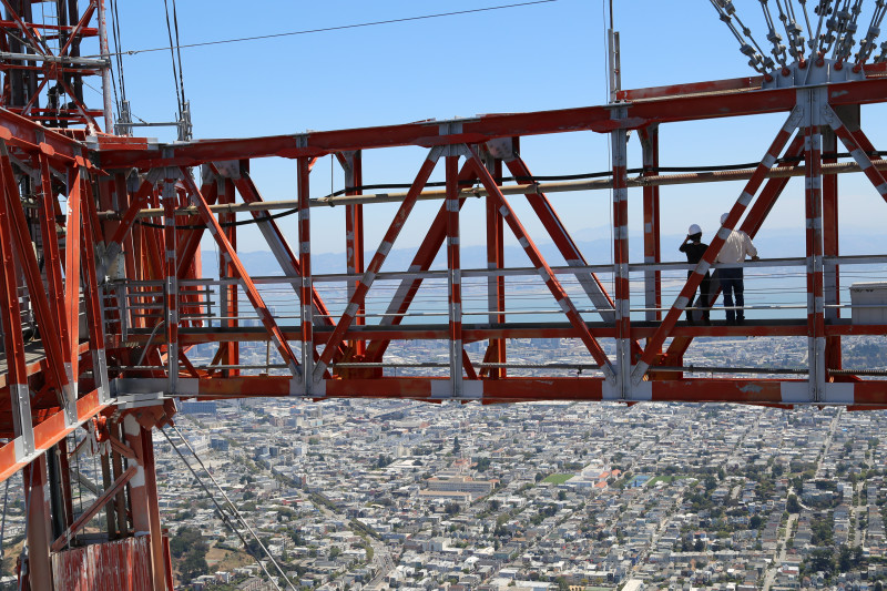 Reporter Jessica Placzek and Sutro Tower Spokesman Dave Hyams near the top of the tower.