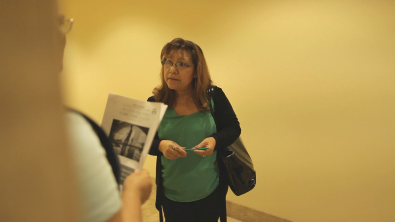 Investigator Vicky Marquez talks to janitors on the night shift about their working conditions.