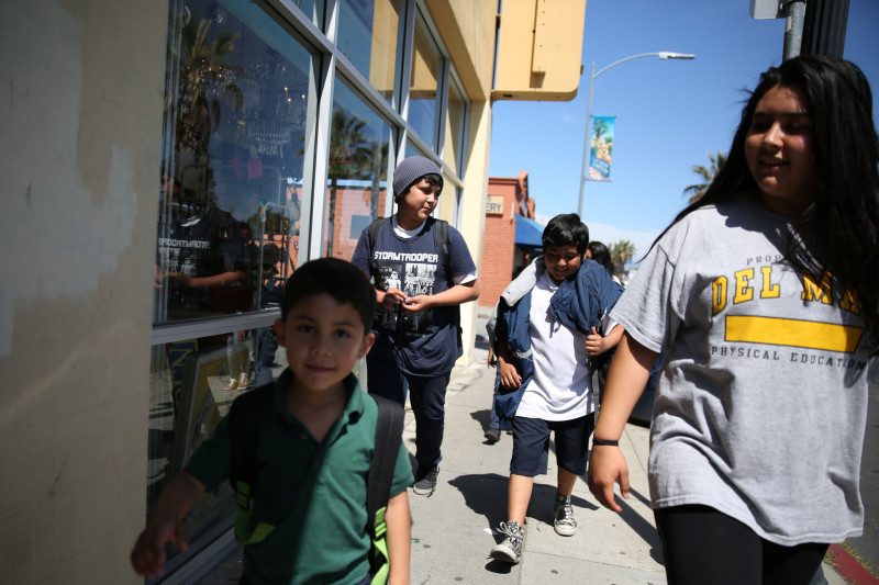 The Luque siblings walk home from school. From left, Valentin, Jose Daniel, Angel, and Lidia.
