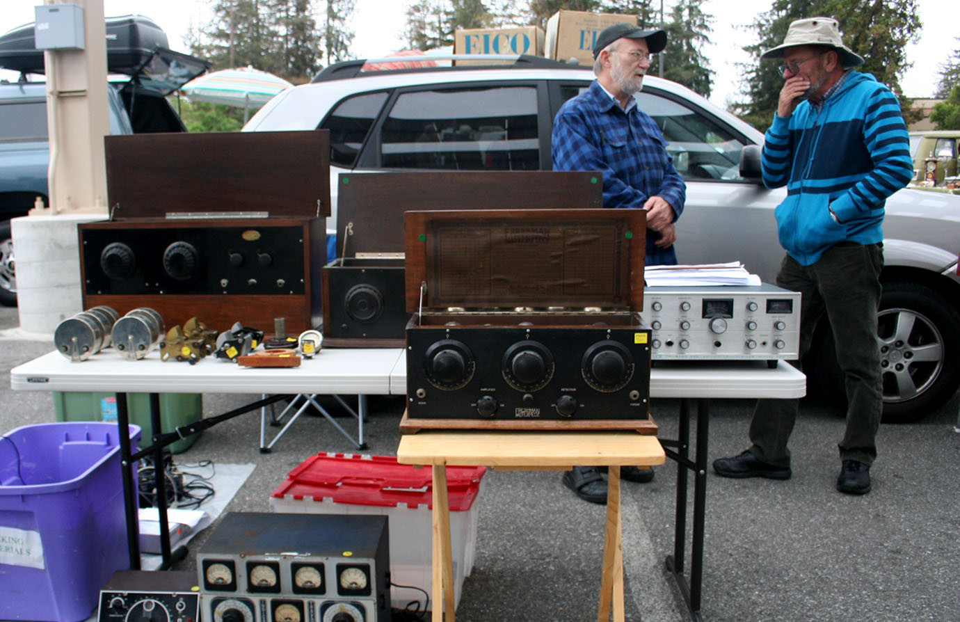 Paul Waltimyer and another man stand behind his antique radios at the Electronics Flea Market.