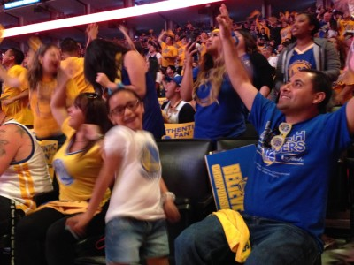 Fans packed Oracle Arena during the Game 6 Watch Party Tuesday night. The Torres family said they needed to be somewhere memorable for game six. (Devin Katayama/KQED)