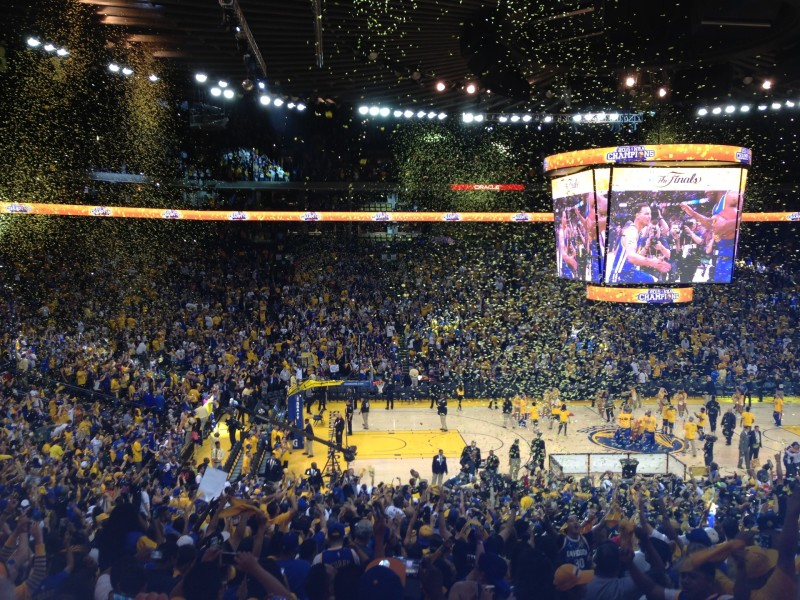 Warriors fans celebrate in Oracle Arena.