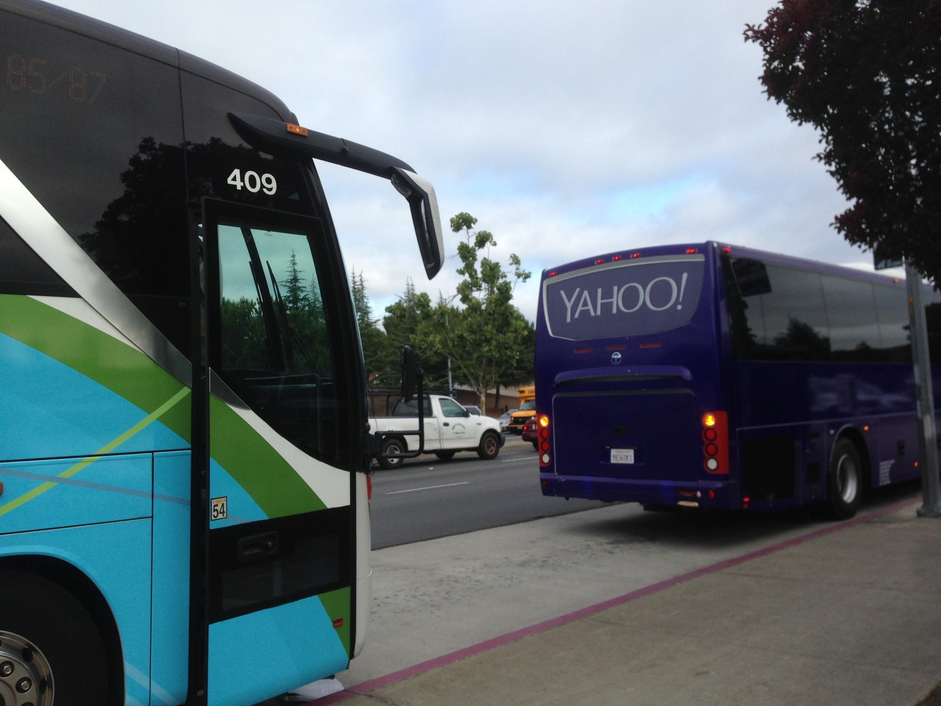 The Camden VTA park and ride is a popular stop for tech shuttles like these two, headed to Yahoo! and Genentech. To San Jose city officials, these buses are pulling away loaded with valuable sales tax revenues, as people who work in other cities likely shop there, too.