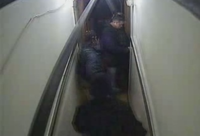 An image from Henry Hotel security camera footage shows SFPD Officer Arthur Madrid inserting a key into the door of room 504. Officer Arshad Razzak is directly to Madrid's right, and Officer Richard Yick is in the foreground. Madrid's partner, Robert Forenis, is to his left.