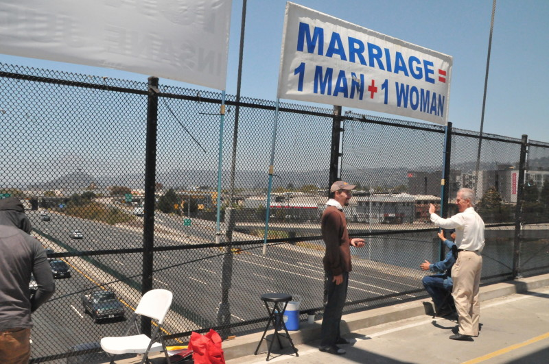 Protesters in Berkeley wave a sign opposing same-sex marriage.