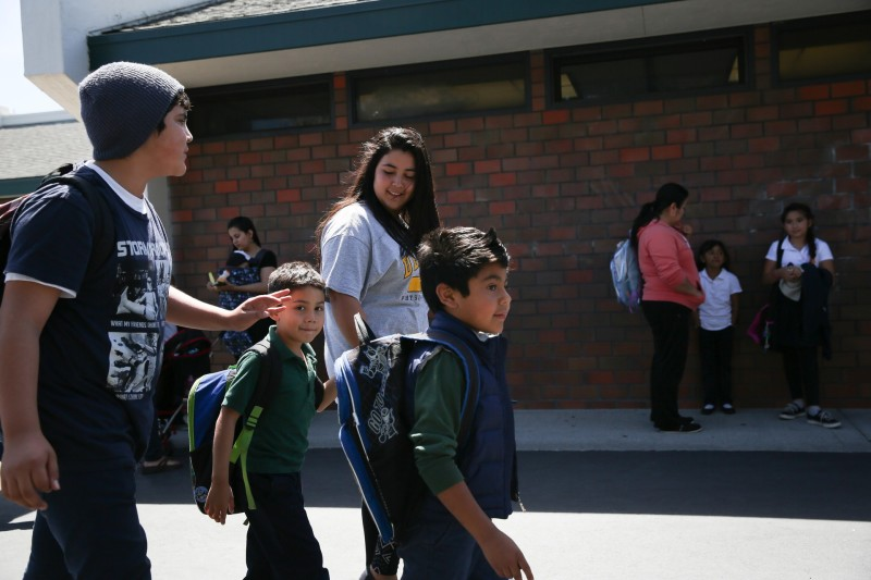 Jose Daniel walks home from school with brothers Valentin and Bryan and sister Lidia.