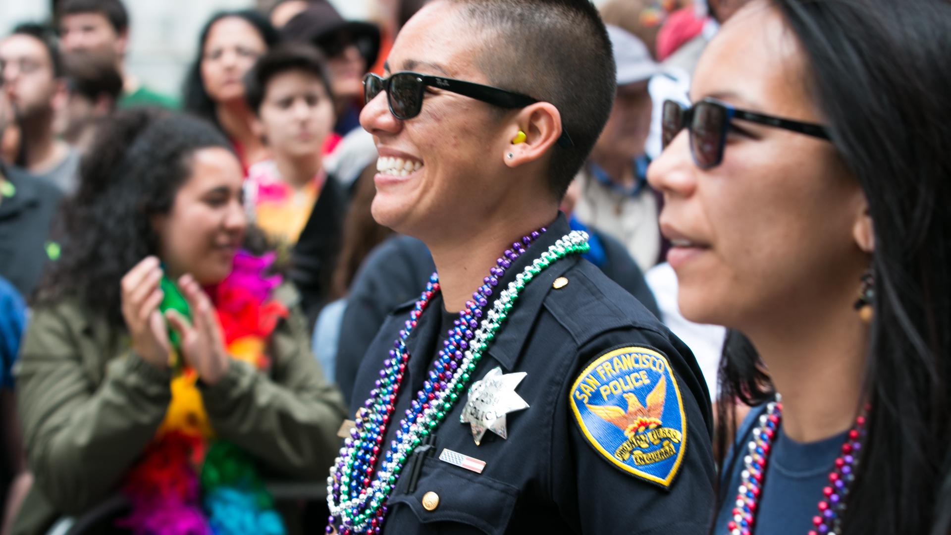 SFPD Officer Jen Foxworth, with wife Dy Nguyen (Jeremy Raff/KQED).