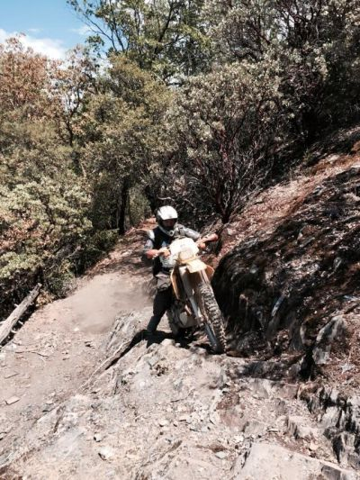 Searcher on a dirt bike on a rugged trail in El Dorado National Forest. San Francisco high school teacher went missing in the forest after leaving on a ride July 17.