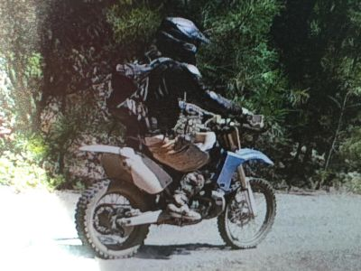 This image of Ed Cavanaugh on his dirt bike was taken July 17 by a wildlife camera in El Dorado National Forest.