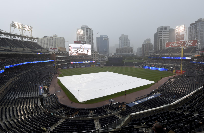 A tarp covers the field at Petco Park during a baseball game between the Colorado Rockies and the San Diego Padres July 19, 2015 in San Diego, California.  Play was suspended in the fifth inning.
