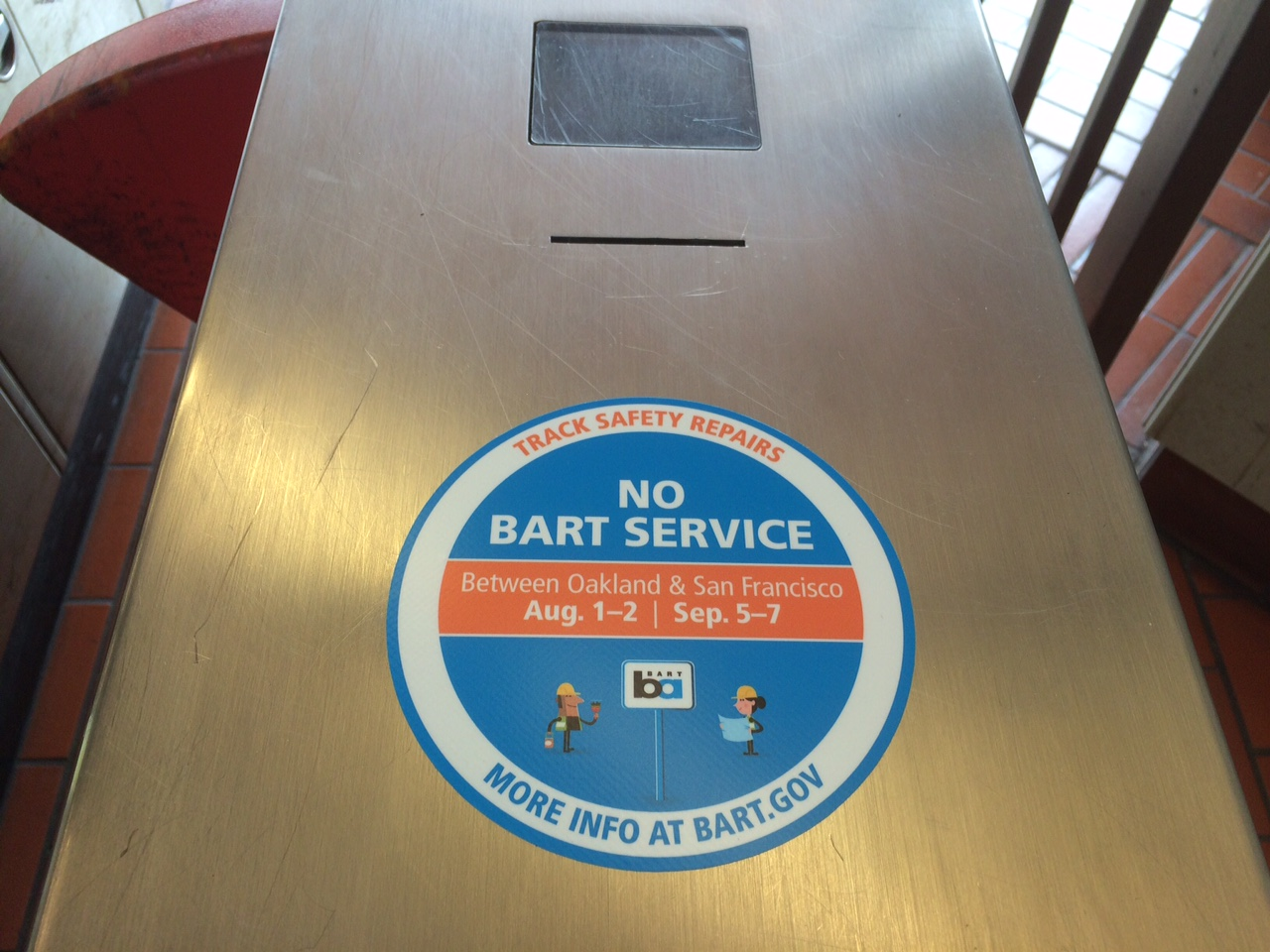 A sticker on a fare gate at North Berkeley BART advertises an upcoming disruption to transbay train service on Aug. 1 and 2 and Sept. 5-7.